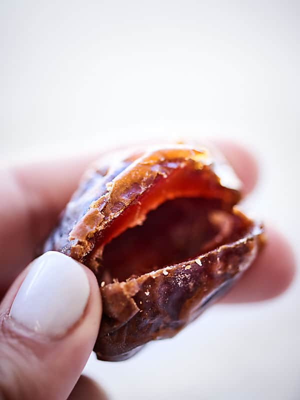 These Bacon Wrapped Dates are perfect for football (or any!) snacking! Only 3 ingredients - bacon, dates, goat cheese - and 20 minutes needed for the easiest and tastiest snack! showmetheyummy.com #baconwrappeddates #goatcheesedates