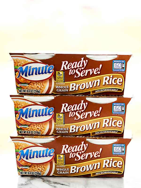 3 packets of microwave brown rice stacked