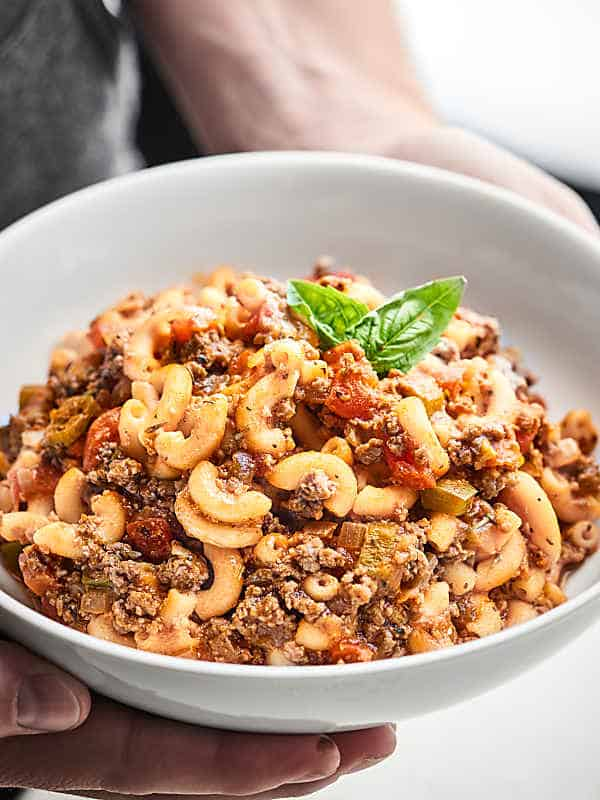 This American Goulash is full of ground beef, vegetables, spices, and macaroni pasta. A one pot wonder on the table in under 30 minutes that's perfect cold weather comfort food! showmetheyummy.com Recipe made in partnership w/ @redgoldtomatoes #HelpCrushHunger #americangoulash