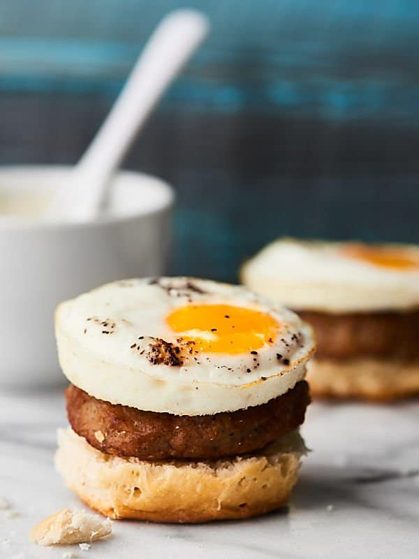 #ad Biscuits and Gravy just got better with these Breakfast and Gravy Breakfast Sliders! Biscuits + maple sausage + gravy + gooey egg! Surprisingly easy! Obviously delicious. :) Recipe made in partnership w/ @jonesdairyfarm #JonesFamilyRules