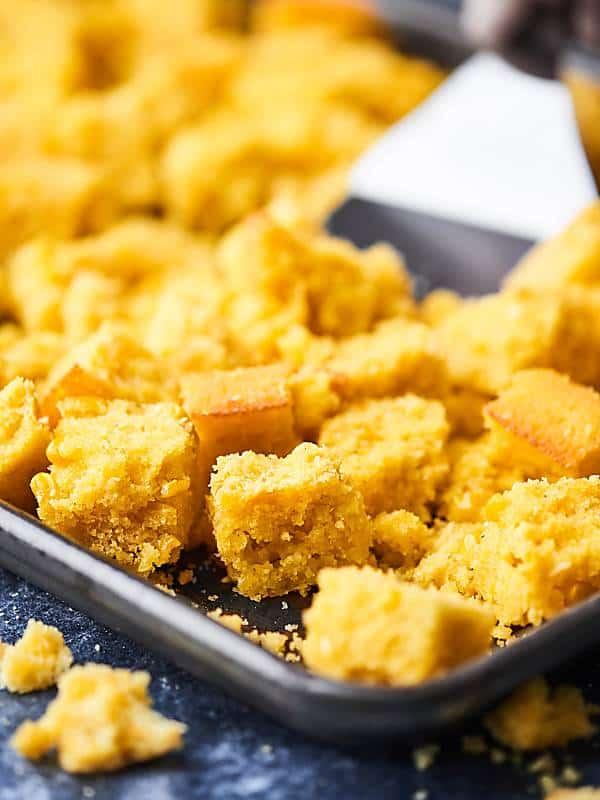 cornbread chunks on baking sheet