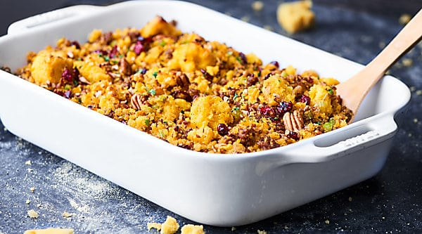 An easy gluten free stuffing, this Cornbread Dressing Recipe will surely impress! Full of italian sausage, vegetables, homemade cornbread, cranberries, spices, and more! showmetheyummy.com #cornbreaddressing #cornbreadstuffing