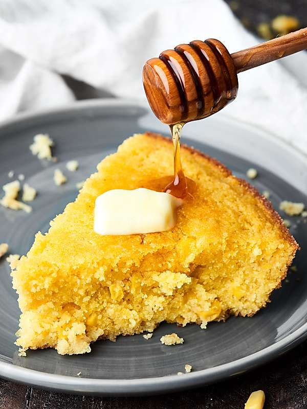 Only ONE bowl and NINE ingredients necessary for this Easy Cornbread Recipe! This cornbread contains no flour - so it's gluten free - and TWO kinds of corn: creamed corn and sweet corn! showmetheyummy.com #cornbread #creamedcorned