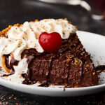 This Red Wine Chocolate Pudding Pie will be the star of your next holiday gathering. A simple graham cracker crust is filled with the most decadent, rich, red wine chocolate pudding! showmetheyummy.com #chocolatepie #puddingpie