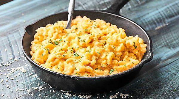 #ad This Slow Cooker Mac and Cheese takes minutes to put together and is full of FOUR kinds of cheese: Asiago, Sharp Cheddar, Monterey Jack, and Gouda, which makes this the best holiday side dish! showmetheyummy.com Made in partnership w/ @Crystal_Farms #cheeselove #CrystalFarmsCheese #slowcookermacandcheese
