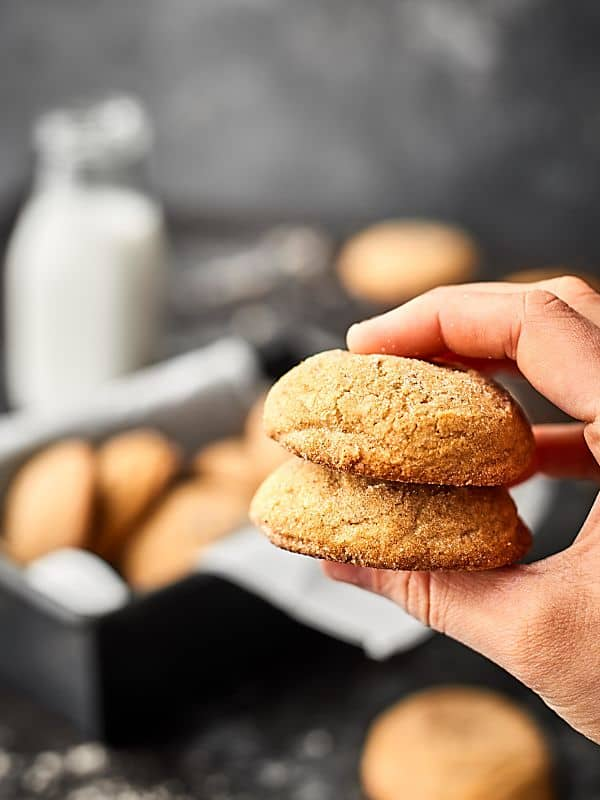 two ginger cookies stacked and held