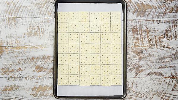 saltine crackers layered on baking sheet