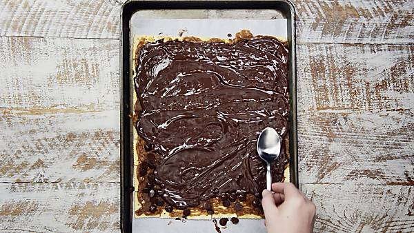 melted chocolate layered on crackers