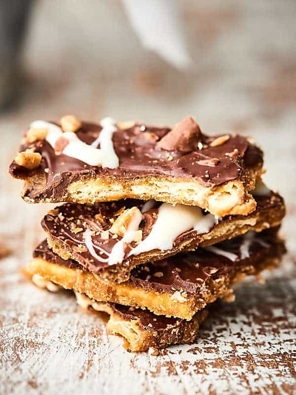 Add this Christmas Crack (aka Easy Saltine Toffee Candy) to your holiday baking list! Only 6 ingredients necessary to make the most addicting holiday treat yet! It's the perfect combo of sweet/salty/crunchy! showmetheyummy.com #christmascandy #christmascrack #saltinetoffee