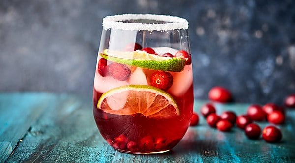 Sweet, tart, and perfect for the holidays, this Easy Cranberry Pomegranate Margarita can be enjoyed by one or shared with many! Only 5 ingredients necessary! showmetheyummy.com #cranberrymargarita #pomegranatemargarita