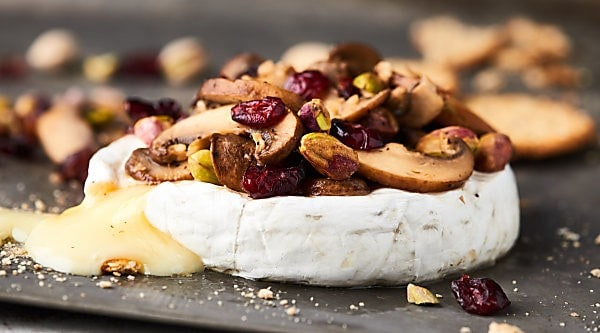 #ad The BEST appetizer yet, this Mushroom Brut Brie is totally impressive, ridiculously easy, and ultra cheesy! Melty brie is topped with brut champagne, buttery mushrooms, and crunchy pistachios! showmetheyummy.com Made in partnership w/ @barefootwine #mushrooms #brie