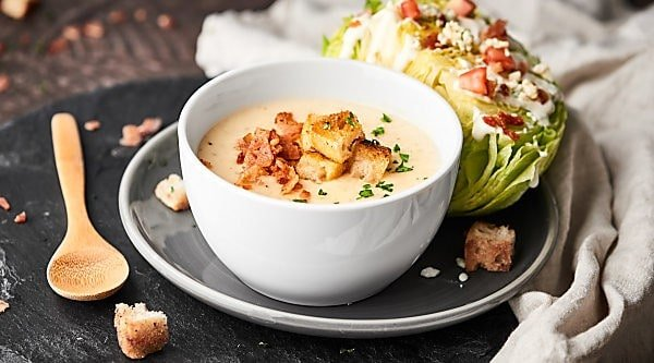 #ad A classic wedge salad with a tangy, sweet blue cheese dressing is paired with the creamiest potato soup to celebrate National Soup Month! showmetheyummy.com Made in partnership w/ @idahoanfoods #wedgesalad #potatosoup