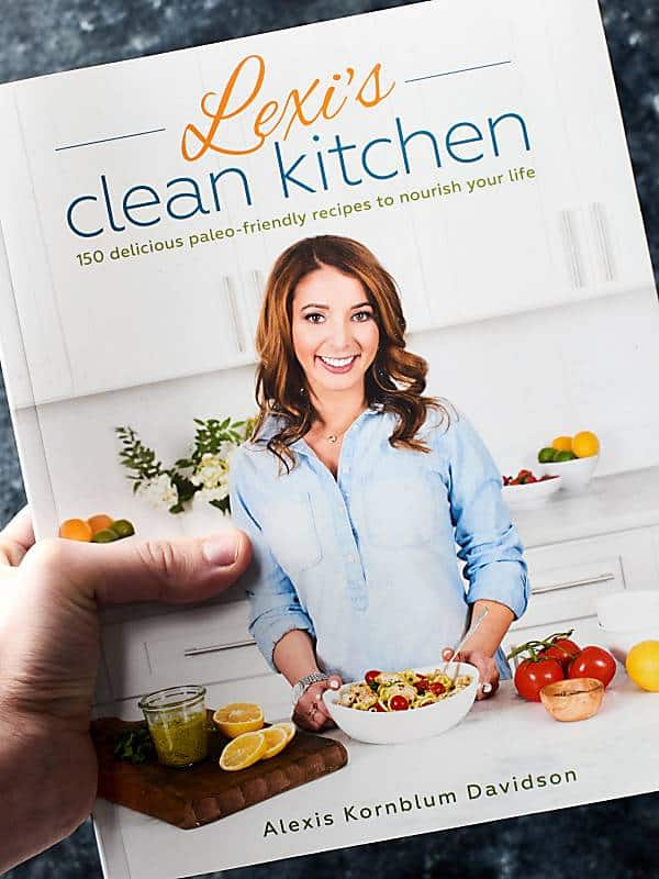 Lexi's clean kitchen cookbook held