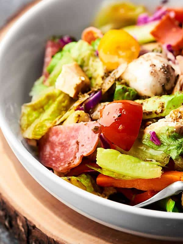closeup of antipasto chicken salad in bowl