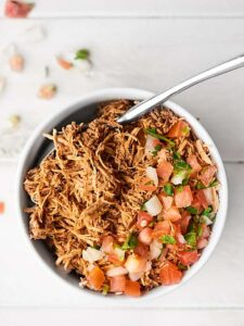 Healthy Crockpot Mexican Chicken. Easy. Flavorful. Gluten Free. HEALTHY! Perfect for meal prep salads, burrito bowls, Taco Tuesdays, nachos, and more! showmetheyummy.com