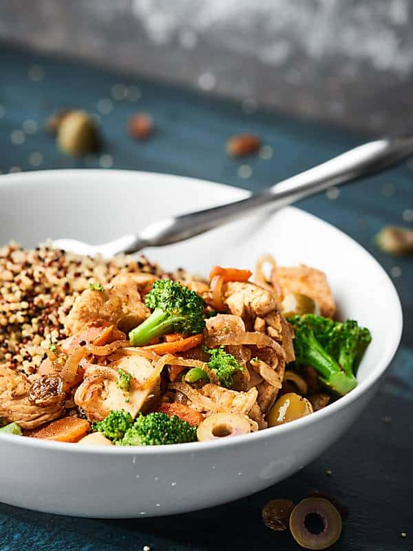 This Easy Moroccan Chicken is a one pot wonder full of tender chicken, sweet carrots, crunchy broccoli, salty olives, and chewy raisins! The perfect dinner for two! showmetheyummy.com