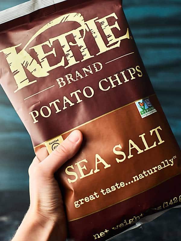 Kettle brand sea salt potato chip bag held