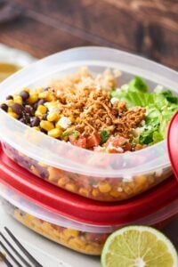 This Chicken Burrito Bowl Recipe is perfect for meal prep! They're quick and easy to make, healthy, gluten free, and loaded with crockpot chicken, beans, corn, a tangy dressing, and more! showmetheyummy.com #burritobowl #mealprep #chicken