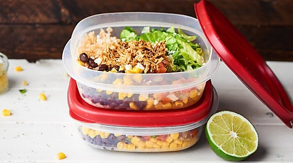 This Chicken Burrito Bowl Recipe is perfect for meal prep! They're quick and easy to make, healthy, gluten free, and loaded with crockpot chicken, beans, corn, a tangy dressing, and more! showmetheyummy.com