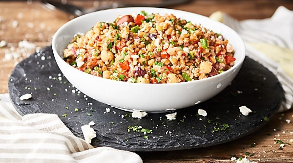 #ad Hearty farro meets loads of fresh, crunchy veggies, tangy red wine vinegar, chickpeas, and spices to make this healthy and delicious Mediterranean Farro Salad Recipe! showmetheyummy.com Made in partnership w/ @bobsredmill