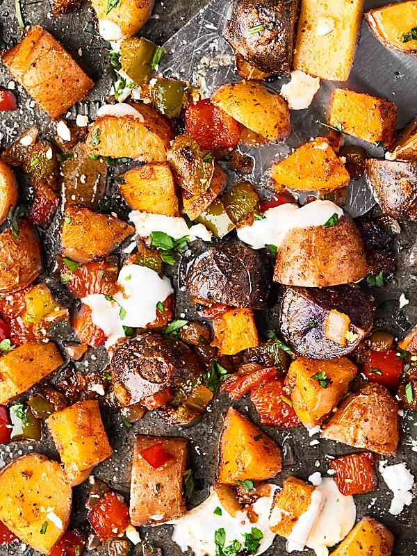 roasted potatoes on baking sheet above