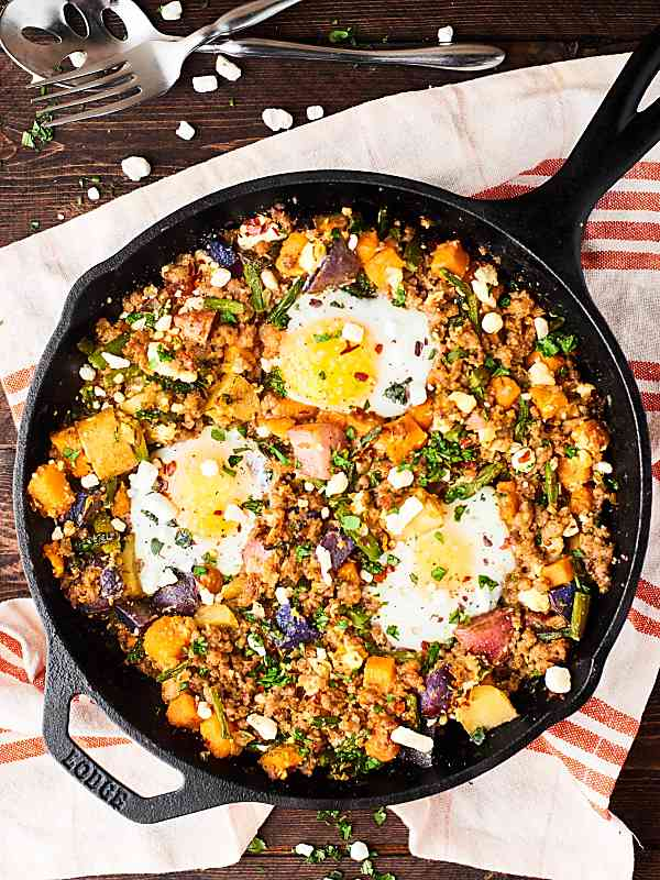 skillet of sausage potato breakfast hash above