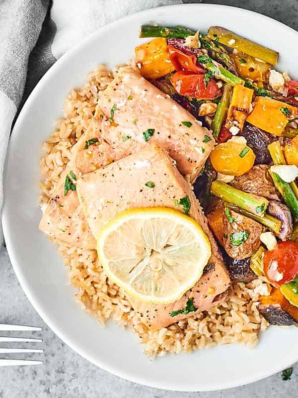sheet pan spring salmon and veggies on plate above