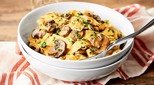 This Vegan Mushroom Stroganoff Recipe is a healthy twist on the classic beef stroganoff & it's loaded w/ mushrooms, spices, almond milk, & a little wine! showmetheyummy.com
