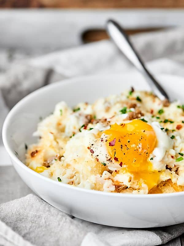 #ad Breakfast Mashed Potato Casserole. Full of sausage, mashed potatoes, panko, and eggs, it's easy, indulgent, and delicious! showmetheyummy.com Made in partnership w/ @idahoanfoods