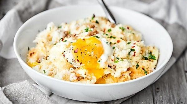 #ad Breakfast Mashed Potato Casserole. Full of sausage, mashed potatoes, panko, and eggs, it's easy, indulgent, and delicious! showmetheyummy.com Made in partnership w/ @idahoanfoods