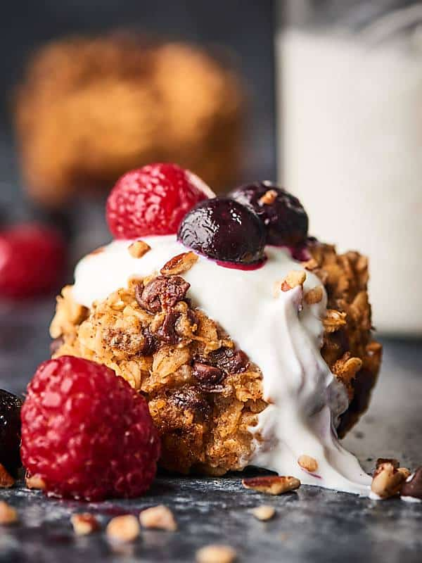 Healthy baked oatmeal cup with berries closeup