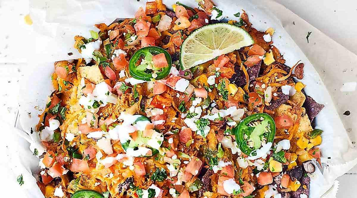 Overhead of dish of loaded chicken nachos