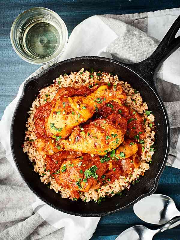 This Haitian Chicken Recipe is a one pot wonder! Full of chicken, tomatoes, wine, spices, and more, this recipe is easy and delicious! showmetheyummy.com