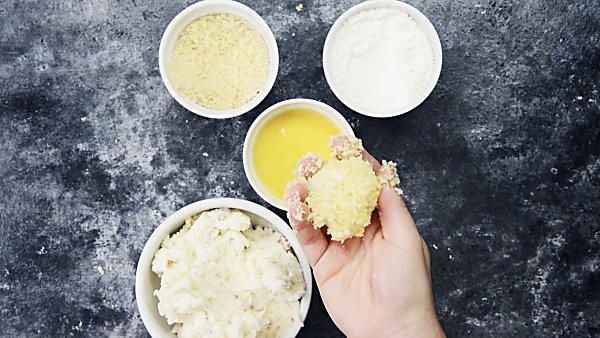 breaded mashed potato ball held