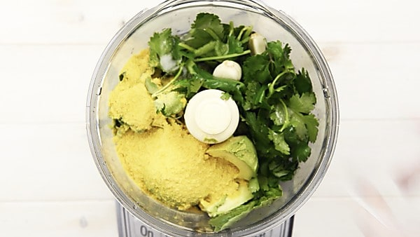avocado pesto ingredients in food processor