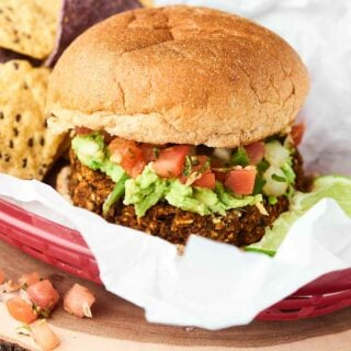 This Black Bean Burger Recipe is PACKED with vegetables and flavor and is super quick and easy to make. All you need is 10 minutes and a food processor! Vegan. Gluten Free. showmetheyummy.com #vegan #blackbean #burger