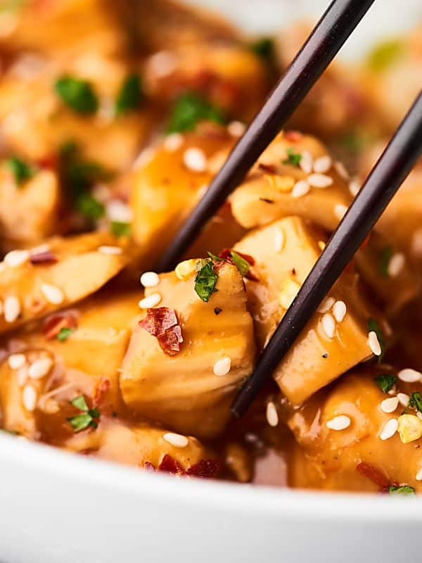This Crockpot Sesame Chicken is a more flavorful, health-i-fied version of a take-out classic! One of my go-to throw and go, quick and easy recipes! showmetheyummy.com
