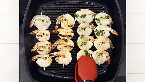 Shrimp skewers being grilled