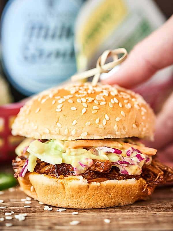 This Instant Pot BBQ Pulled Pork Recipe comes together in a matter of minutes and cooks in only 90 minutes! A quick, easy, pretty darn healthy weeknight dinner that's packed with tender pork and a tangy homemade BBQ sauce! showmetheyummy.com