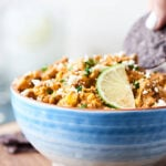 Instant Pot Mexican Corn Dip. This easy, cheesy, creamy deliciousness is ready in about 15 minutes and is loaded with cream cheese, fresh corn, mayo, and loads of spices and fresh herbs! The perfect dip for tortilla chips! showmetheyummy.com