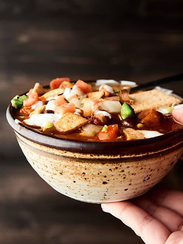 This Crockpot Vegetarian Chili is vegan, gluten free, SO healthy, and loaded with veggies, spices, and THREE kinds of beans! showmetheyummy.com