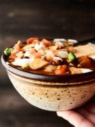 This Crockpot Vegetarian Chili is vegan, gluten free, SO healthy, and loaded with veggies, spices, and THREE kinds of beans! showmetheyummy.com #vegan #vegetarian #chili #crockpot #slowcooker #glutenfree