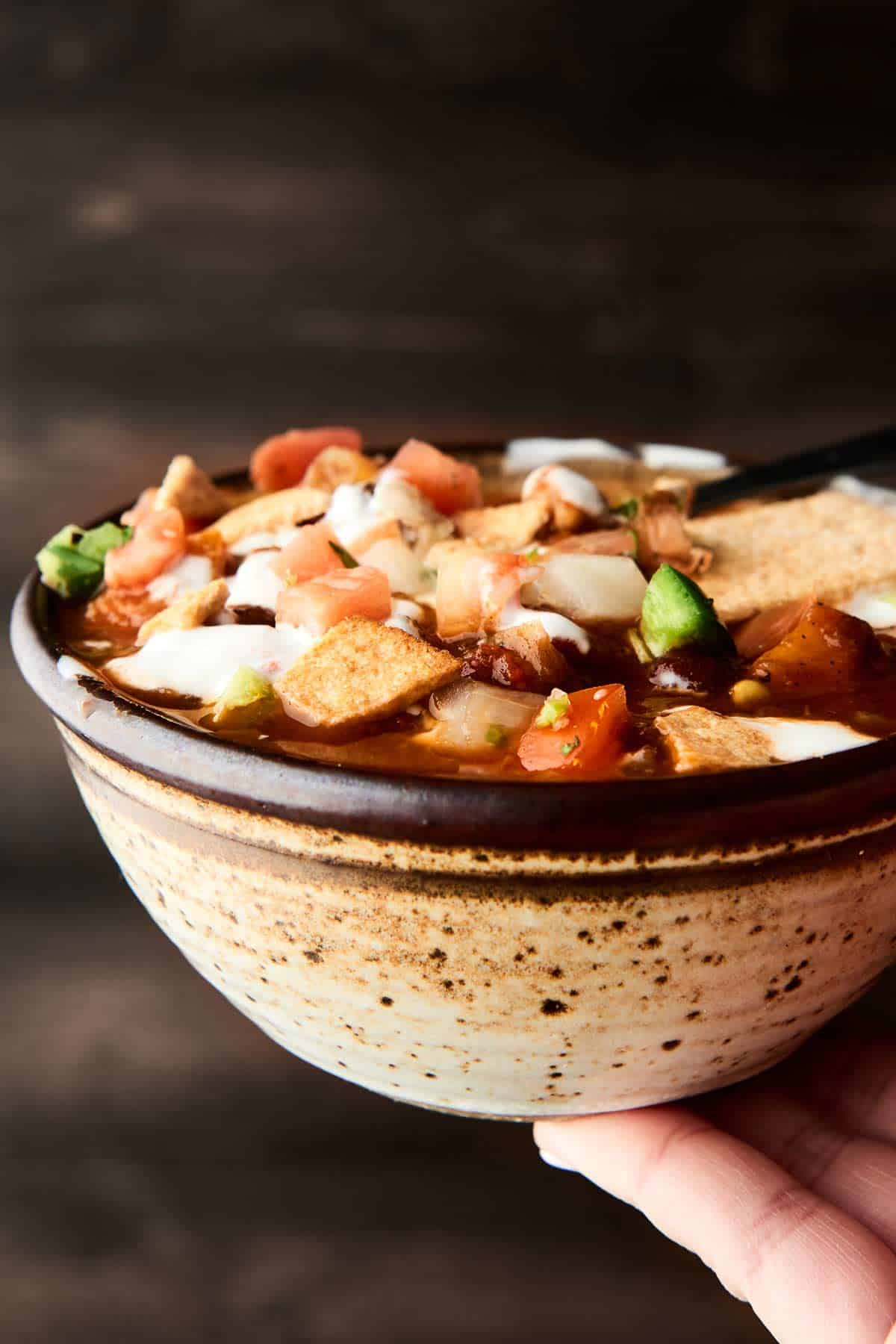 Bowl of vegetarian chili held