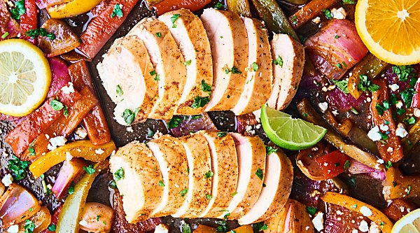 These Sheet Pan Chicken Fajitas are healthy, gluten free, and full of veggies, tender chicken, and spices! Minimal clean up for an easy weeknight dinner! showmetheyummy.com