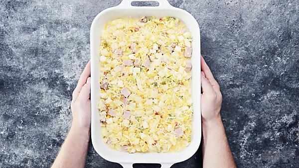 unbaked ham and cheese breakfast casserole in baking dish