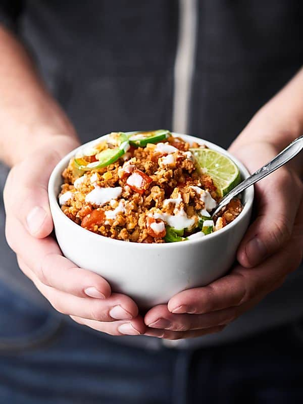 This Taco Cauliflower Rice Skillet is quick, easy, healthy, low carb, and absolutely delicious! Loaded with ground turkey or chicken, vegetables, and frozen cauliflower rice! showmetheyummy.com