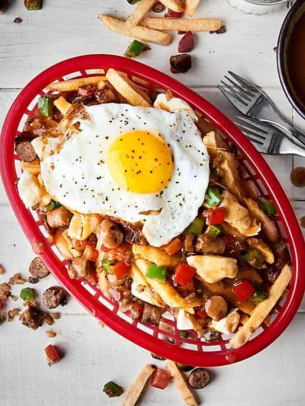breakfast sausage poutine in basket above