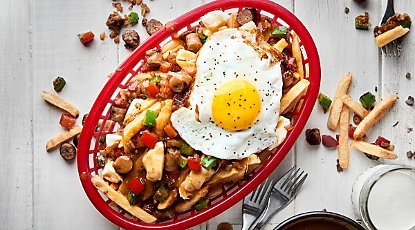 #ad This Breakfast Sausage Poutine is made with french fries, homemade gravy, breakfast sausage, peppers, onions, and cheese curds! showmetheyummy.com Made in partnership w/ @smithfieldfoods