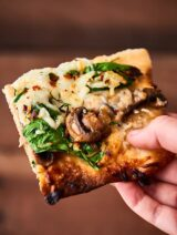 #ad Caramelized Onion and Mushroom Pizza. Thin crust topped with onions, mushrooms, spinach, tons of cheese, and a little thyme! showmetheyummy.com Made in partnership w/ @Pillsbury #Pillsbury