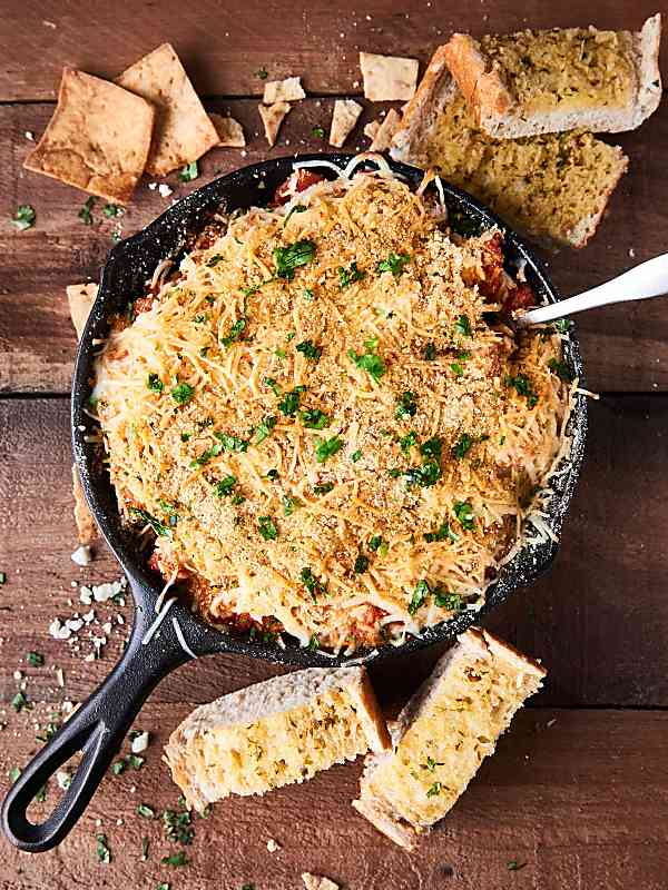 chicken parmesan dip in skillet above